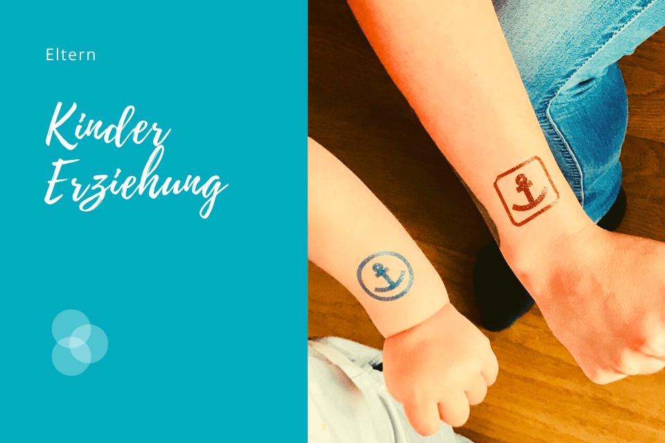 Kindererziehung auf Augenhöhe braucht Übung – Frauen- und Kinderarm mit Anker-Tattoo